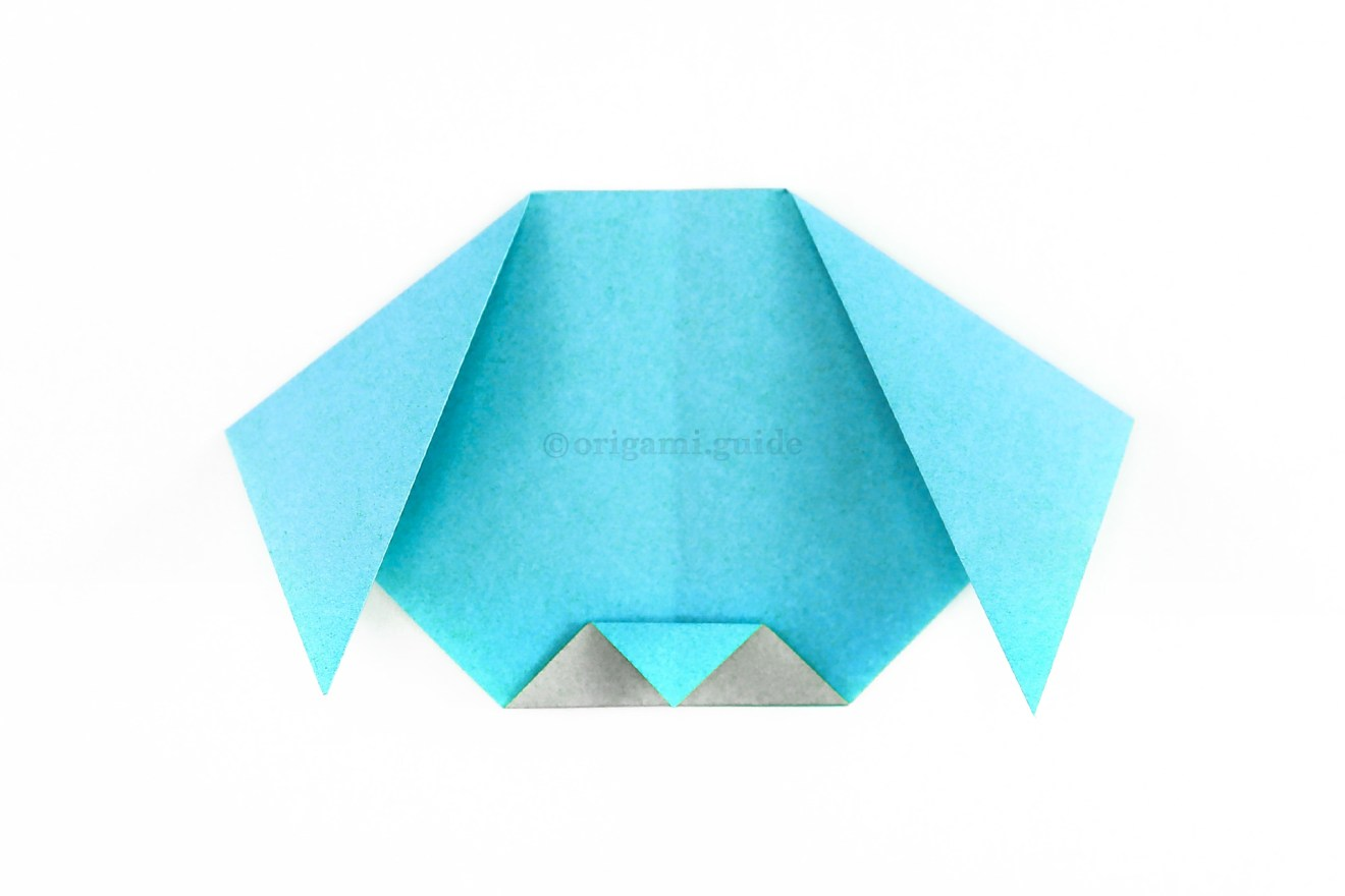 Fold the top point of the flap down to the bottom to finish the nose.