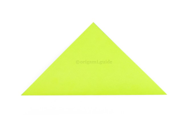 Fold the paper diagonally in half so that you have a triangle shape.