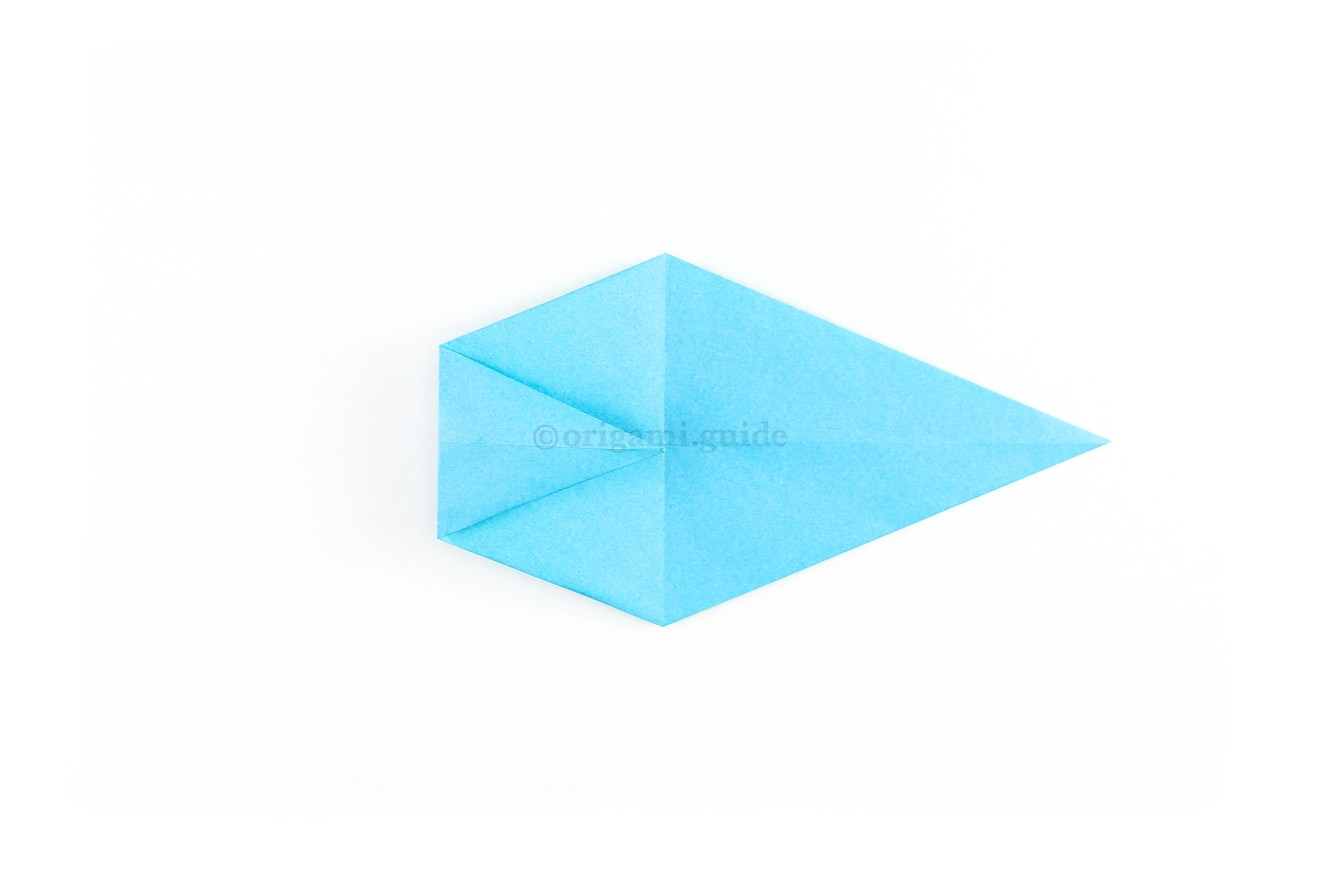 Fold the left point to the central vertical crease.