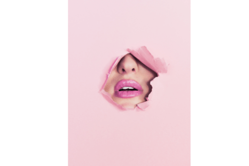 mouth breaking through pink paper