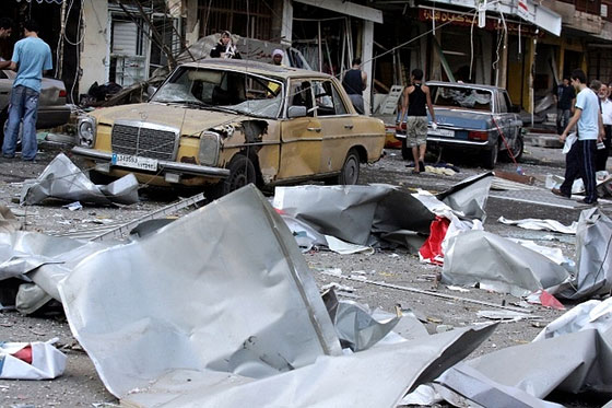 Destroyed cars and damages from homes lie in ruins after being hit by early morning Israeli air strikes on the Hezbollah-stronghold suburb of Dahyieh in July 2006 (AFP)