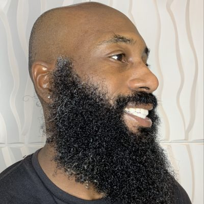 Beard Care for Black Men - Image is of a man with a well-moisturized beard.