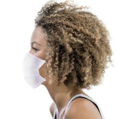 Profile portrait of an African American woman wearing a facemask to avoid the coronavirus – social distancing concepts
