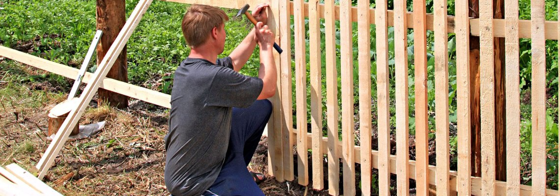 man building a fence