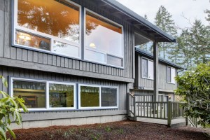 Addition to Split Level Home with Small Cantilever and Warm Grey Siding