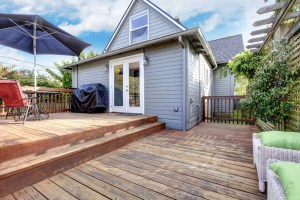 Small 1-Story Backyard Addition with Double Doors onto Wood Deck