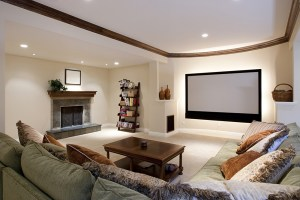Basement Living Room with Large TV, Fireplace and Stained Wood Crown Molding