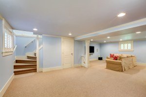 Basement Living Room Remodel with Winder Stairs and Central Beam and Posts