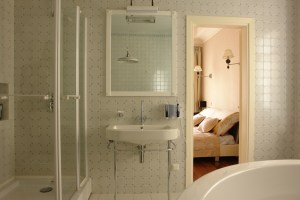Bathroom Remodel with Retro Wall Tile, Entry Level Shower Enclosure and Console Style Vanities