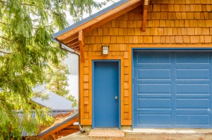 Garage Remodel with Stained Shingle Siding, Bright Blue Doors and Trim, and Stained Exposed Rafter Tails and Brackets