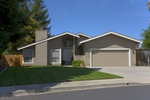 Garage Remodel on Modern Style House with Low Sloped Roof and Grey Painted Exterior with White Trim