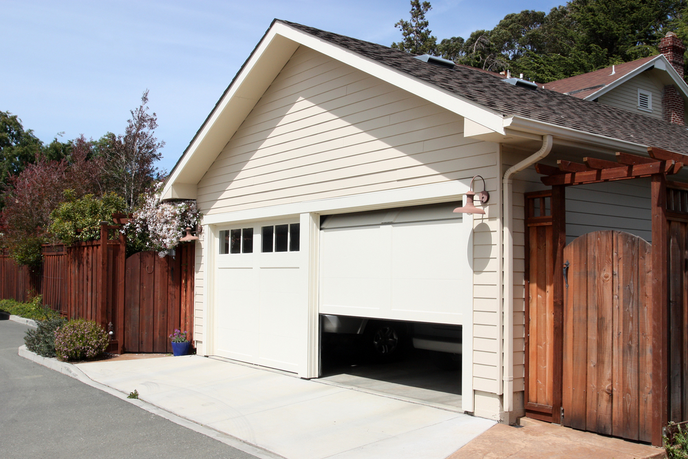 Marvelous Garage Remodel With White Painted Siding, 2 Single Car Overhead Doors And  Stained Wood Fence