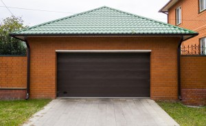 Garage Remodel with Orange Brick Exterior, Green Faux Clay Tile Roof and Large Brown Overhead Door