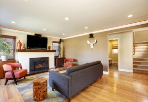Interior Remodel Living Room with Fireplace, Stained Wood Mantel, TV above and Flanking Windows