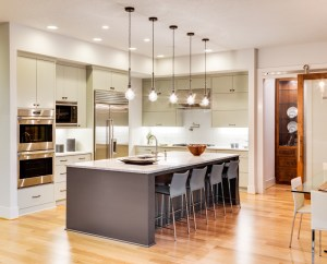 Kitchen Remodel with Two-Tone Cabinetry, Marble Countertops, Large Island with Great Lighting and Open Floor Plan
