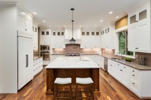 Kitchen Remodel with Inset Painted White Cabinets, Light and Dark Stone Countertops, Full Height Grey Porcelain Tile Backsplash, Built-in Fridge and Hardwood Flooring