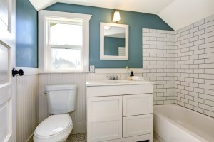 Whole House Remodel with 3-piece Bathroom including White Subway Tile, Painted Wood Wainscot and Hexagon Floor Tile in this 2nd Level Dormer