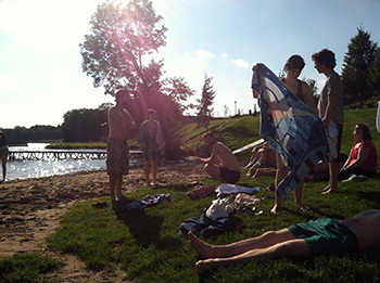 Singers take a quick (and chilly) dip in the lake at Wichrowe Wzgórze before orientation. Photograph by Lauren Bock.