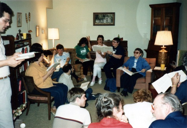Singers from Chicago and Downstate Illinois singing at a social at the Steinmetz home, during the second Illinois State Convention, September 1986. Members of the two groups met at a Sacred Harp presentation by the downstate group at the Libertyville School of Folk Music.