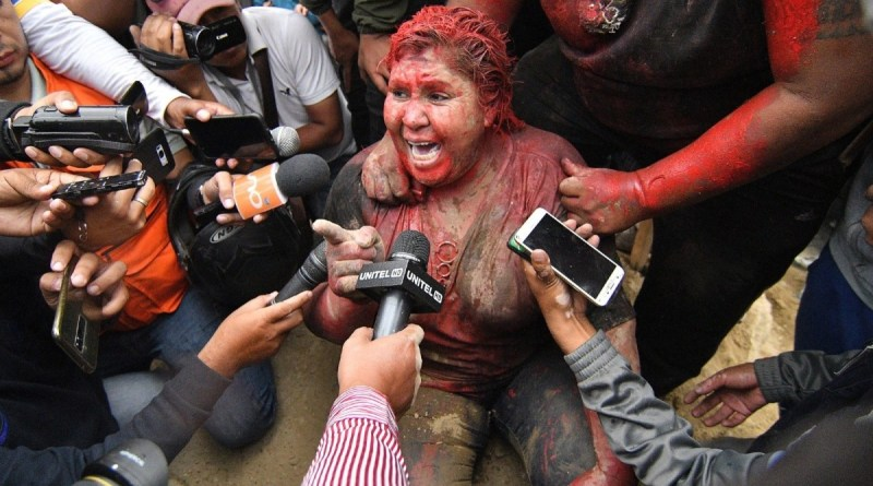 Bolivian Mayor, Patricia Arce, Covered in Paint, Dragged Through the Streets by Right Wing Fascists (Racism, Misogyny)
