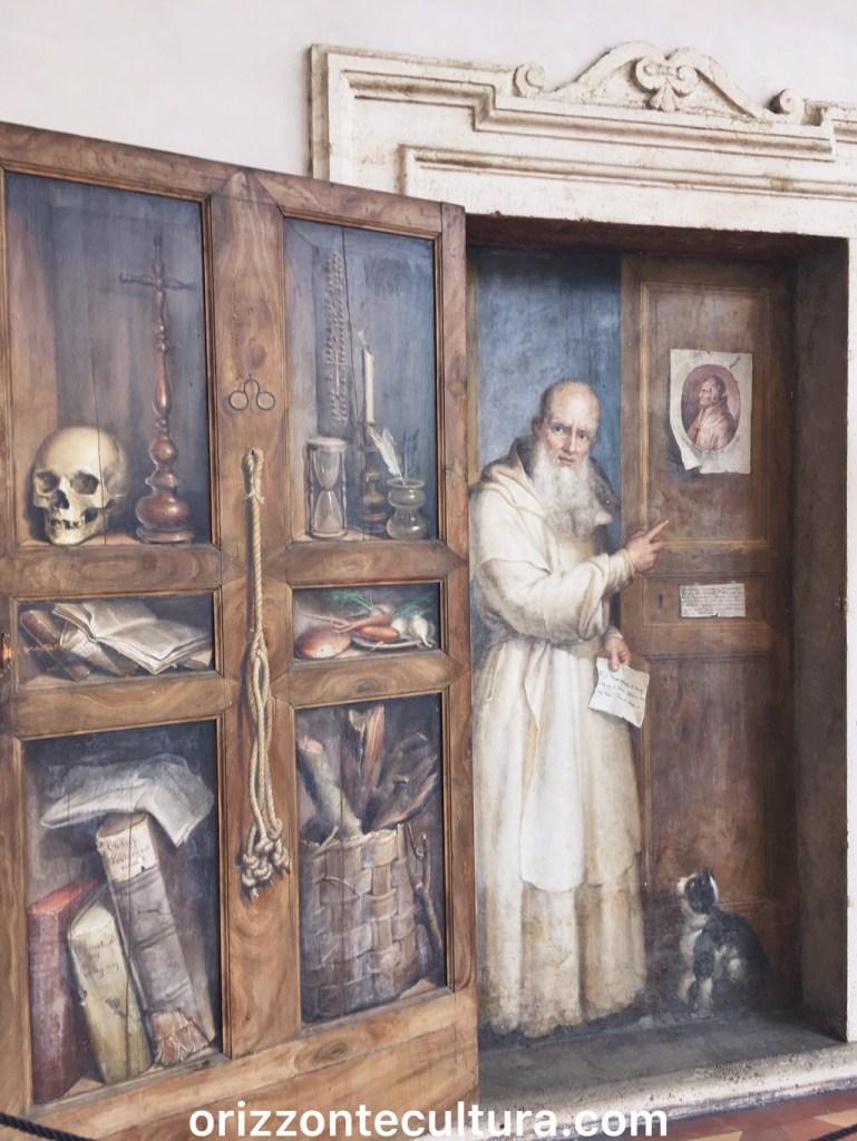 La porta dipinta con il certosino Fercoldo realizzata da Filippo Baldi nel 1885