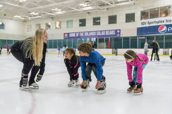 Ice skating Orlando: image of teacher and children ice skating at the RDV Ice Den in Maitland, Florida