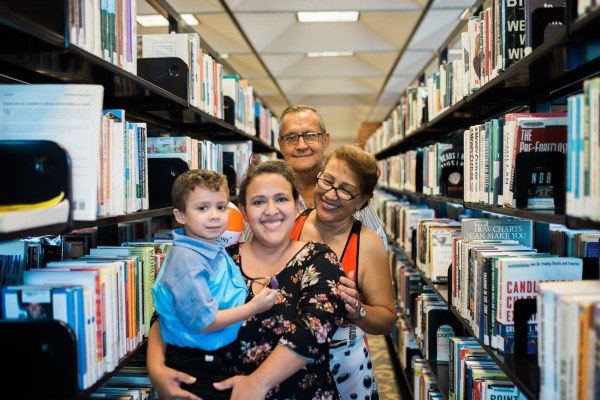 Free things to do in Orlando: image of family enjoying the public library in Orange County