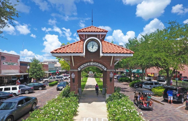 Date night ideas: image of downtown entrance with bike trails and brick lined streets in downtown Winter Garden