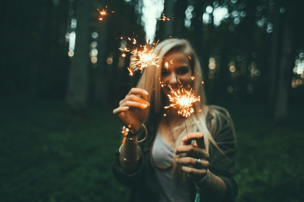 4th of July Orlando: image of girl holding sparklers outside