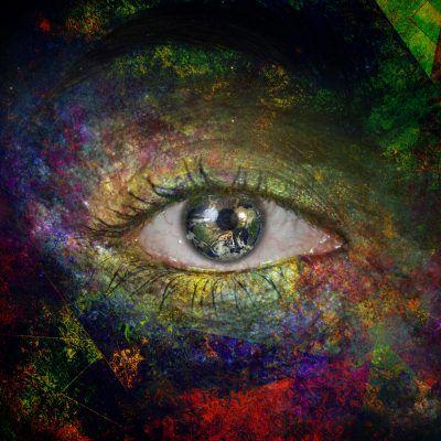 Surrealism. Woman's eye with galaxies. Earth map credit NASA https://visibleearth.nasa.gov/view.php?id=73909