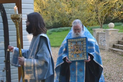 Priest Antony Bardsley and Deacon Mark Tattum-Smith welcome the Kursk-root Icon to the parish in Mettingham.