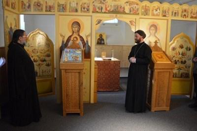 Bishop Alexander greeting by Priest Ioann in Bern