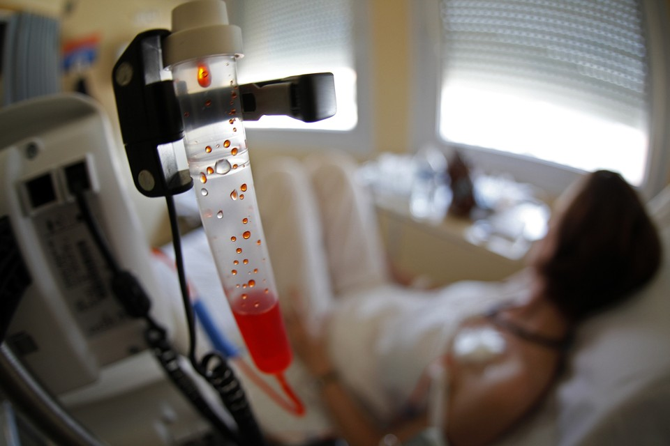 A patient receives chemotherapy treatment for breast cancer at the Antoine-Lacassagne Cancer Center in Nice