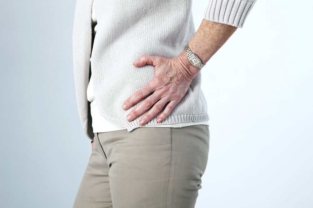 older person suffering from hip pain