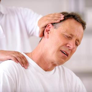 Cervical Spondylosis treatment: Chiropractor doing neck adjustment
