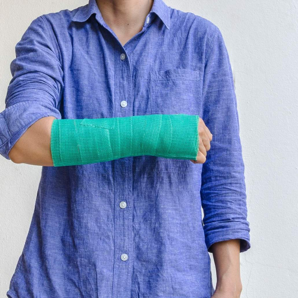 Woman with wrist fracture in cast