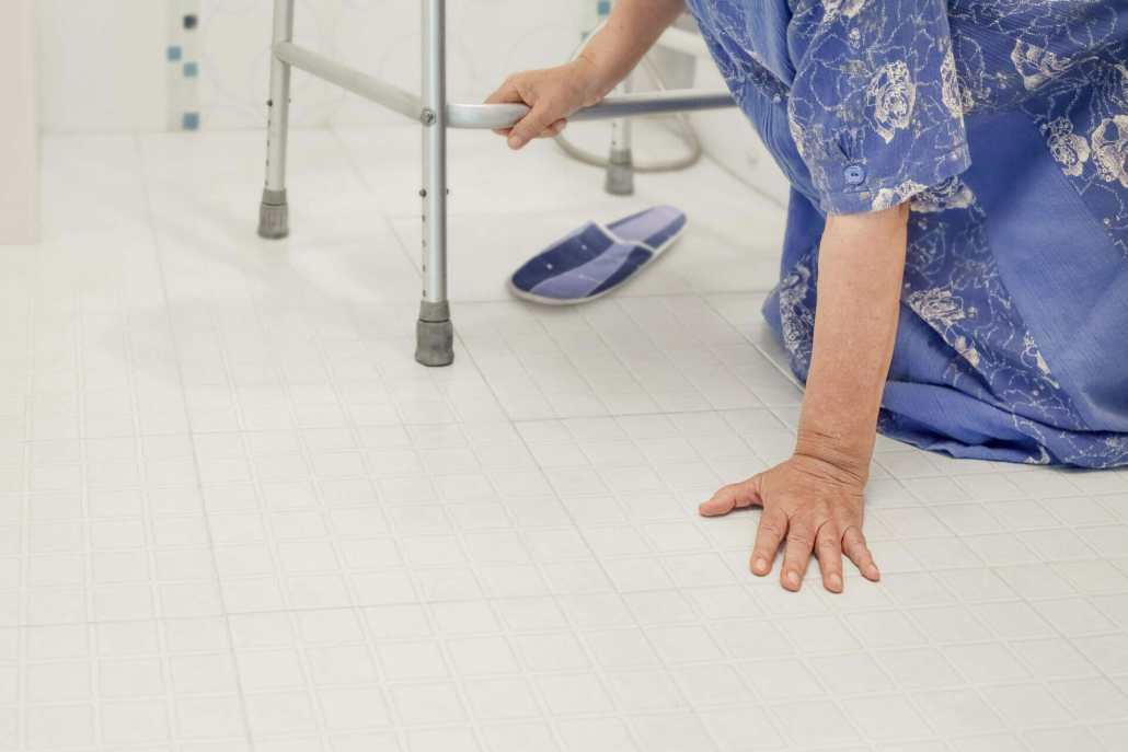 Elderly woman falling and fracturing wrist