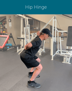 Orthopedic Institute Spine Therapist demonstrates how to properly hip hinge in order to avoid back pain and ensure a neutral spine.