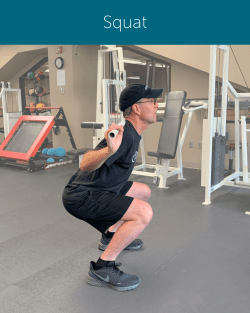 Orthopedic Institute Spine Therapist demonstrates a proper squat form while ensuring a neutral spine.
