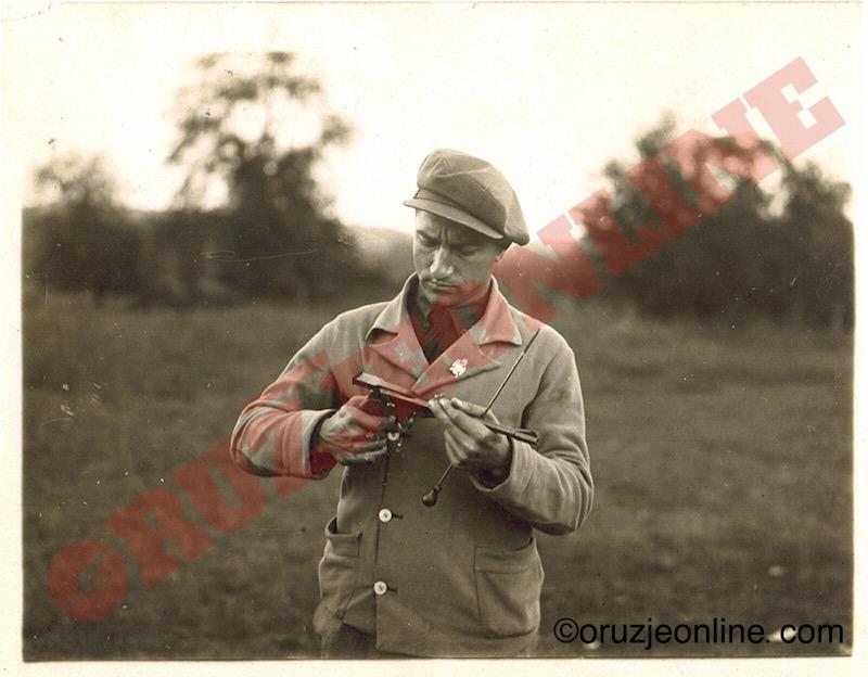 Lazar Yovanovitch  with his own target pistol.  Belgrade shooting range,  1937.