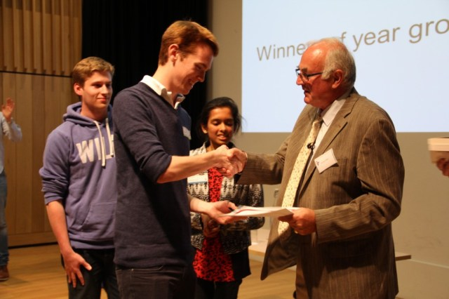 Richard Blair presents the winners in the older age category with their prizes