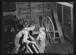 Jack Delano. On a rainy day Mr Lemuel Smith, FSA Farm Security Administration borrower sharpens some of his co-operatively owned farm implements Carroll County Georgia