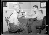 John Vachon. Farmer applying to Farm Security Administration county supervisor for rehabilitation loan Oskaloosa Kansas