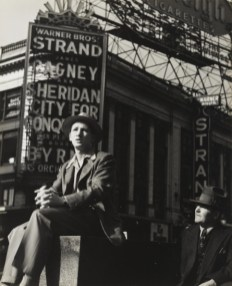 Lou Stoumen. Sitting in Front of the Strand, Times Square, 1940