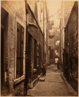 Thomas Annan Plate 6- Close, No. 65 High Street. The tenements leaning in contributed to the claustrophobic nature of the closes.