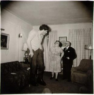 A Jewish giant at home with his parents in the Bronx, N.Y. 1970 Diane Arbus