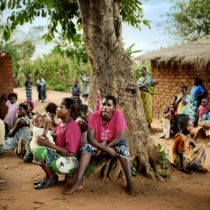 Women waiting in Fumbwe village.