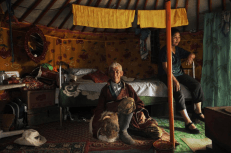 "Like their ancestors before them, herders Janiyansuren and Chantsal have been nomads all their lives. Even though the family herds have been decimated by the dzud (""winter disaster""), they will remain on the steppe while most of their children have moved to the city."