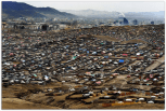 More than half of Ulaanbaatar's 1.2 million people live in the ger districts that have formed as ex-herders have given up the nomadic life en masse to pitch their gers on the hills surrounding the city. These districts are little better than shantytowns, lacking running water or proper roads.