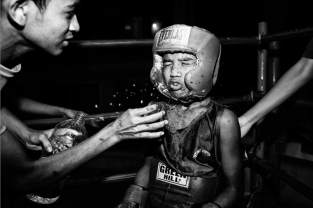 A group of young boyes practices boxing in the Mohammad Ali Boxing stadium every day. Dhaka, Bangladesh.